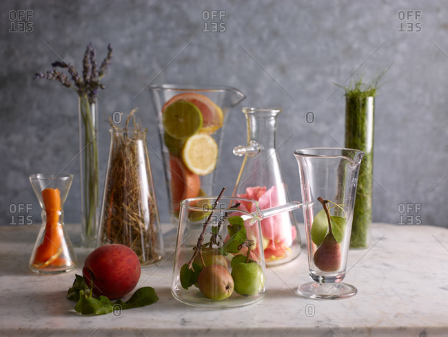 Glassware filled with fruit and leaves