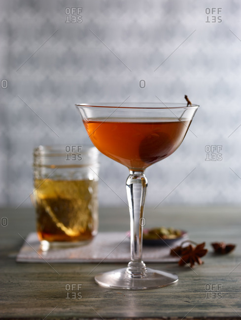 Whiskey garnished with a cherry