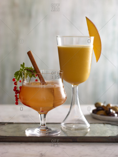 Two garnished cocktails