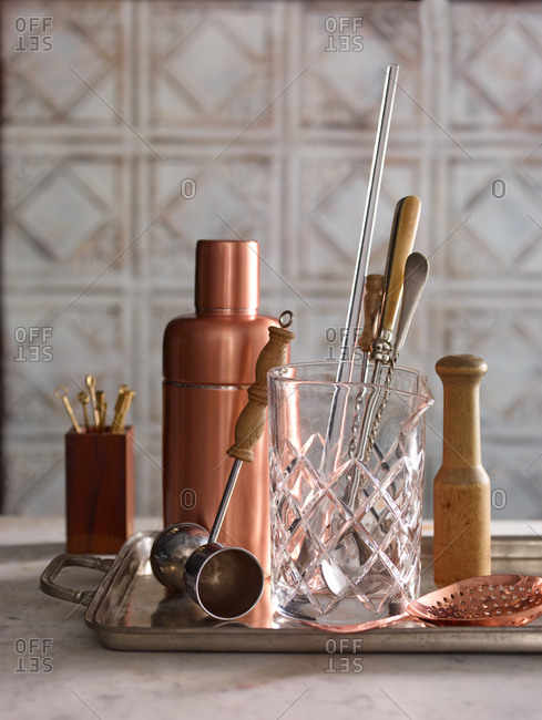 Collection of bar tools on a metal serving tray