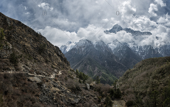 Hiking trail and mountains in clouds, Khumbu