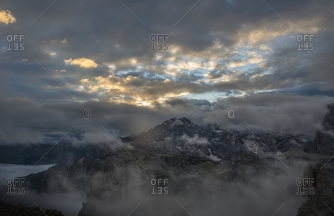 View to Cadini di Misurina mountains at sunrise on a cloudy day, Dolomites