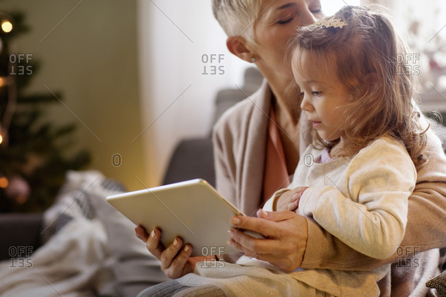 Girl and her grandmother with a tablet computer