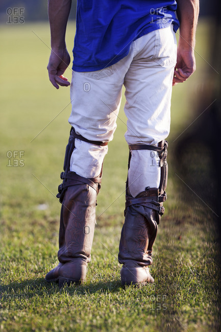 Polo player wearing boots and knee guards