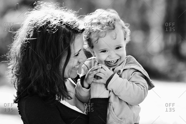 Portrait of mother and giggling toddler boy