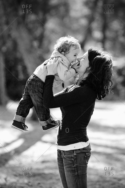 Portrait of a playful toddler boy and his mother