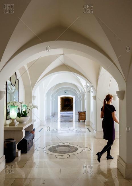 Paphos, Cyprus - May 8, 2015: Woman in vaulted hallway in Cyprus resort
