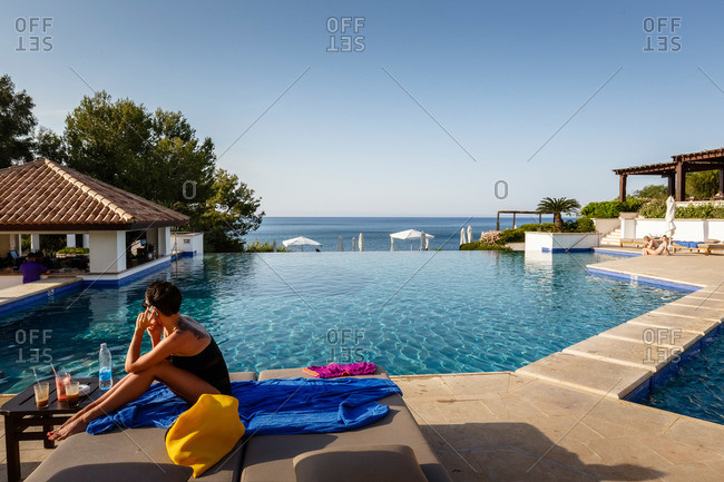 Paphos, Cyprus - May 8, 2015: Woman poolside in Cyprus