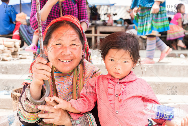 Bac Ha, Lao Cai Province, Vietnam - May 9, 2015: A portrait of a young Vietnamese girl with her Grandmother in Bac Ha, Lao Cai Province, Vietnam