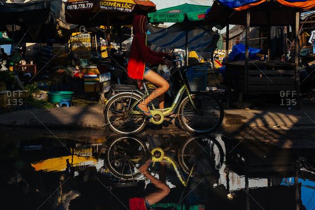 Phu Quoc, Vietnam - November 10, 2015: Woman bicycles on Phu Quoc Island, Vietnam