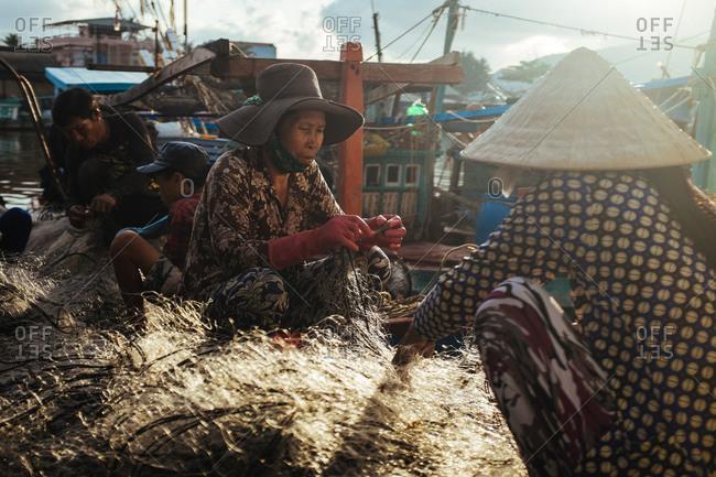 Phu Quoc, Vietnam - November 11, 2015: People fixing fishing nets, Phu Quoc Island, Vietnam