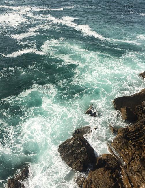 Waves crashing on rocks in the Meditteranean