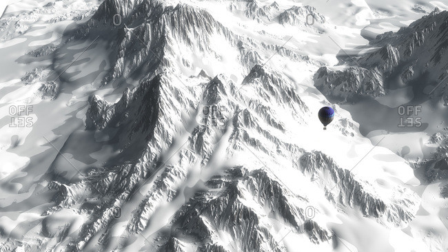 Elevated view of hot air balloons flying over snowy mountain range