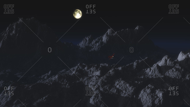 Single engine airplane over otherworldly mountain landscape in moonlight
