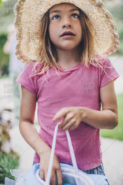 Little girl holding an Easter basket