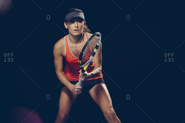 Brunette athletic woman playing tennis