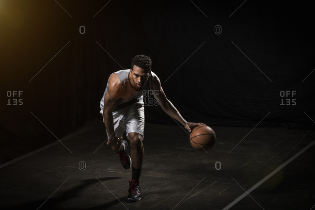 Athletic man dribbling a basketball
