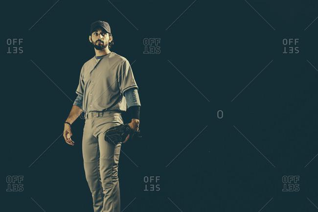 Athletic man in a baseball uniform