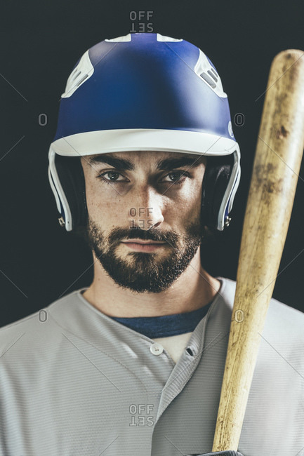 Portrait of a baseball player standing with a baseball bat