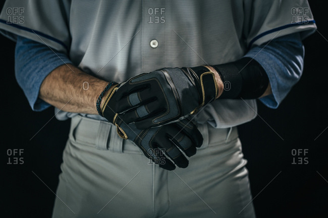 Close up of a baseball player wearing batting gloves