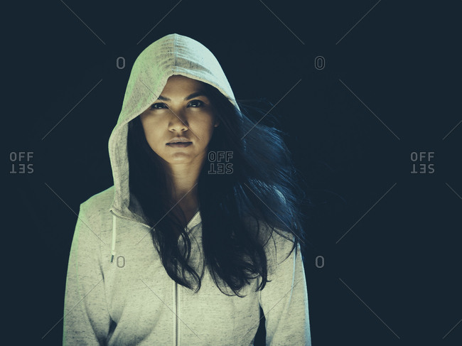Portrait of a woman in a hoodie