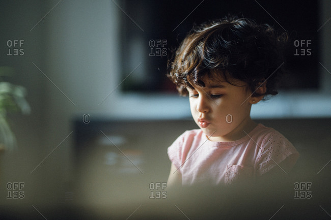 Little girl in a pink shirt puckering her lips
