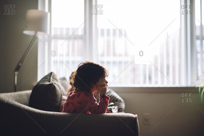 Young girl sitting on a couch