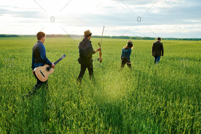 Band carrying instruments in a field