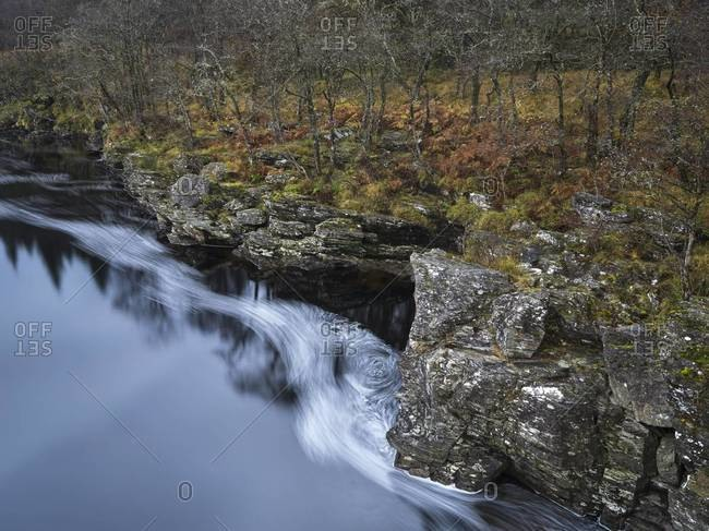 Swirling water and river bank in the Orchy River Valley in Scotland