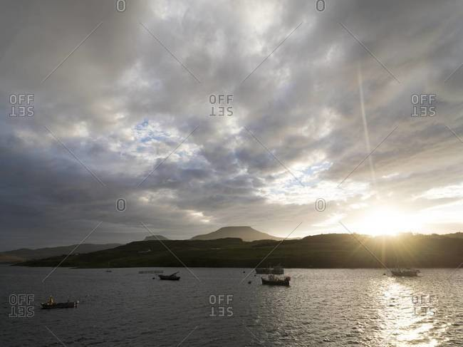 Boats anchored off shore in Dunvegan on the Isle of Skye, Scotland