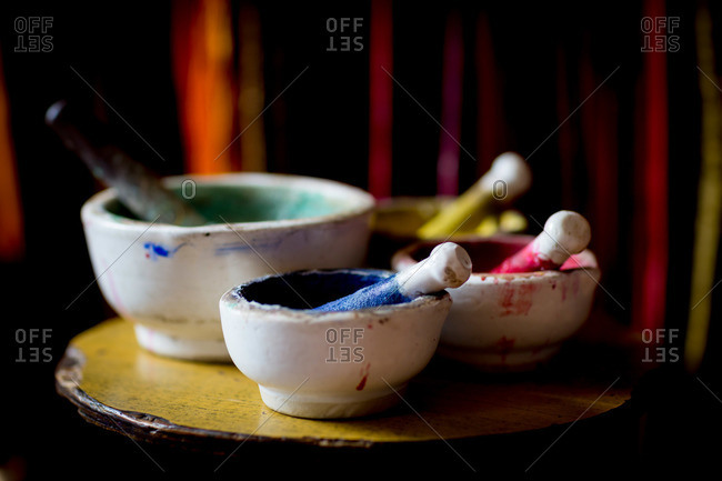 Bowls of paint await to be applied to a Nepal Thanka painting