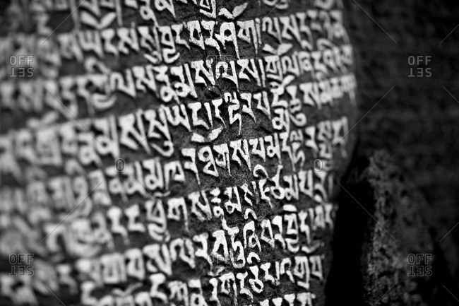 Tibetan Buddhism script is engraved on Mani Stones in Nepal's Everest Region