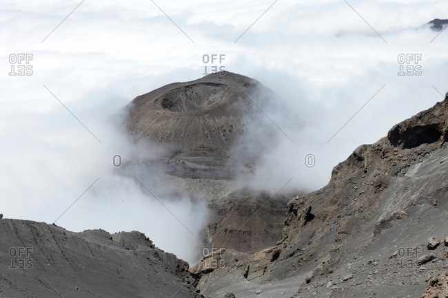A look down in the crater of volcano Mount Meru, a trekking mountain in Africa