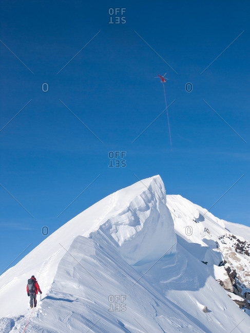 A mountaineer on the summit ridge of Denali, formerly known as Mt McKinley, in Alaska