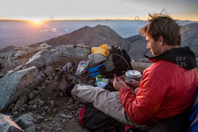 A man camping on the summit of Little Bear Peak, Alamosa, Colorado