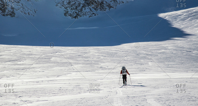 A skier skins across a wide open expanse of snow during the Spearhead Traverse in the Coast Mountains of British Columbia, Canada