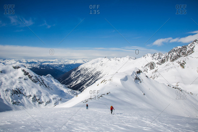 Skiers in a wide open landscape during the Spearhead Traverse in the Coast Mountains of British Columbia, Canada