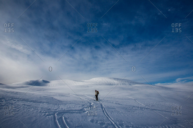 A skier descends a snow-covered peak in British Columbia while skiing the Spearhead Traverse near Whistler, Canada