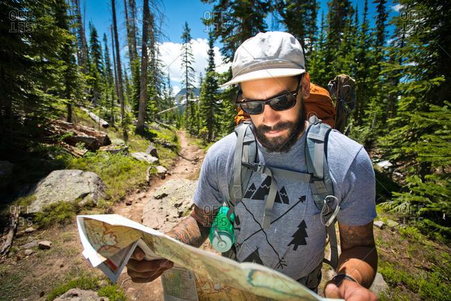 A hiker reading a map