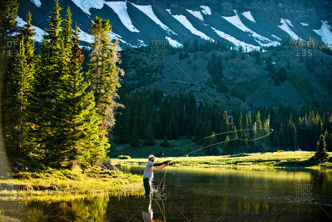 A fly fisherman in a high alpine lake