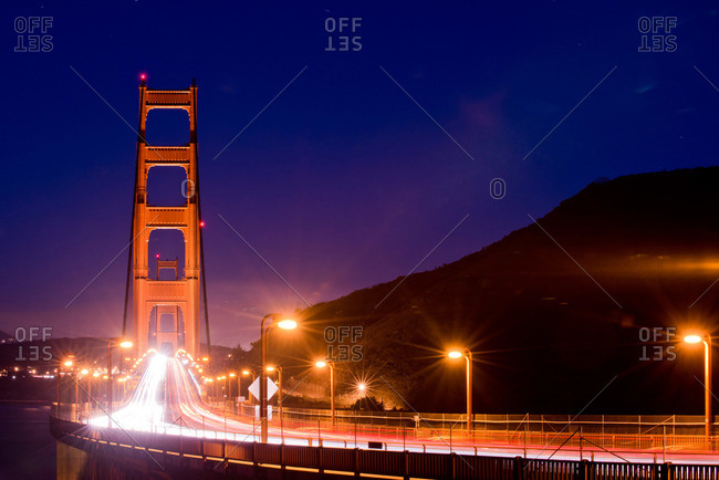 A long exposure of cars going over the Golden Gate Bridge