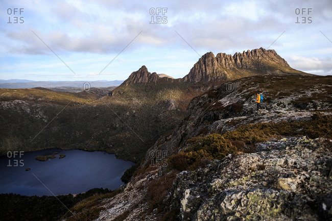Hiker on Cradle Mountain ridge line in Tasmania