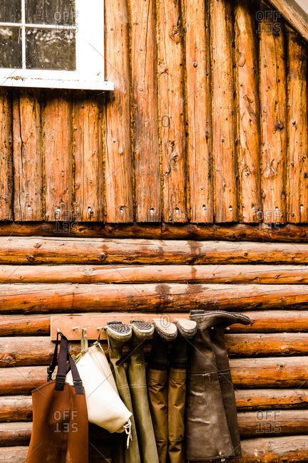 Waders drying outside of a cabin