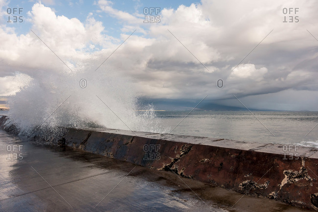 A wave breaking over a wall