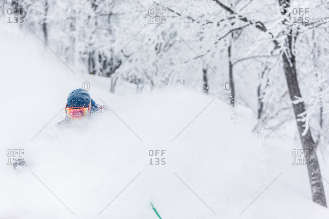 Person powder skiing