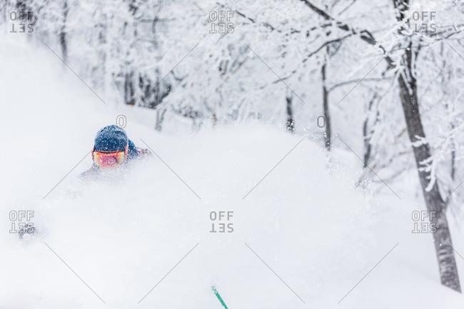Person powder skiing