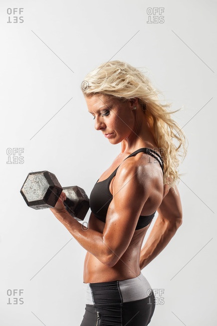 Woman lifting hand weights doing bicep curls
