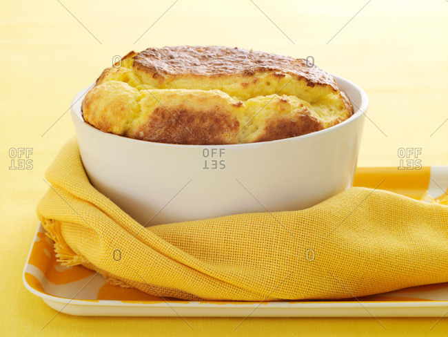 Fresh baked souffle and yellow fabric napkin