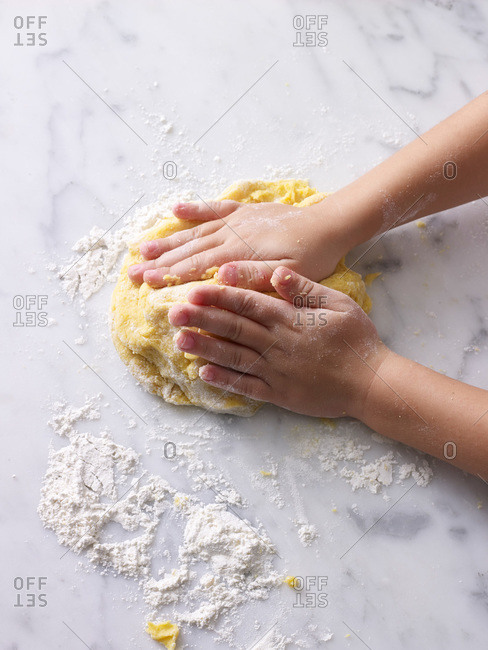 Boy's hands kneading pasta dough