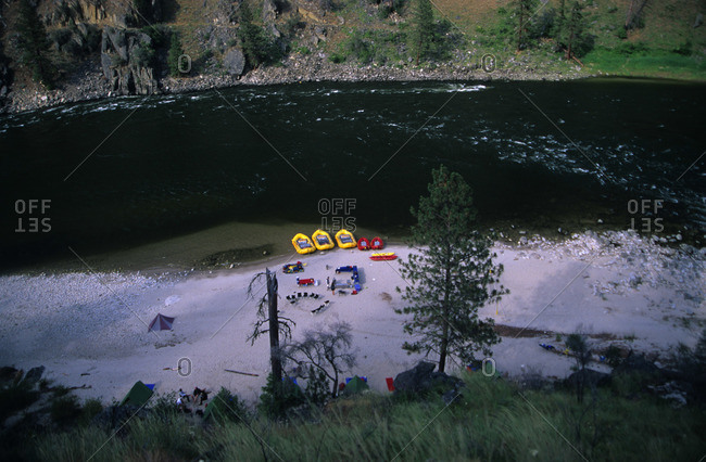 Inflatable boats on the beach of a rushing river